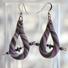 These purple stripey earrings have an Industrial piercing, beaded with hematite.