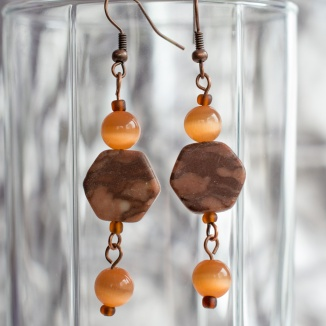 Fideline earrings with orange beads